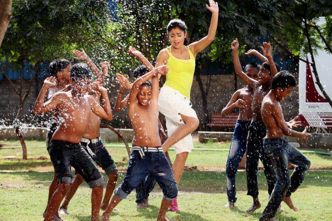 Shriya Saran Dancing With Children Photo Still From Movie Pavitra
