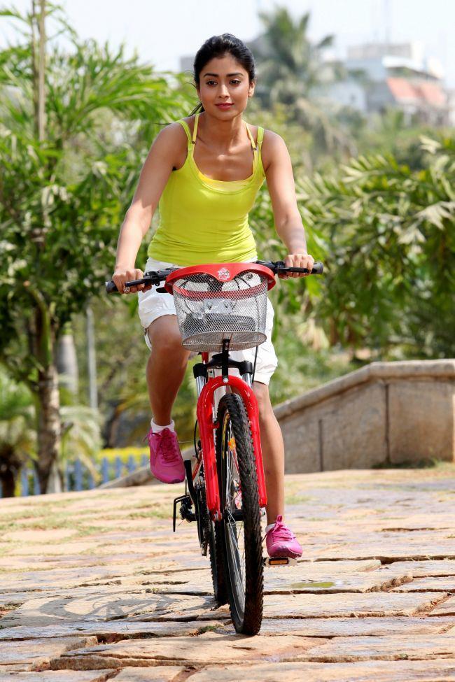 Shriya Saran Dazzling Look Photo Still In Cycle Ride From Movie Pavitra