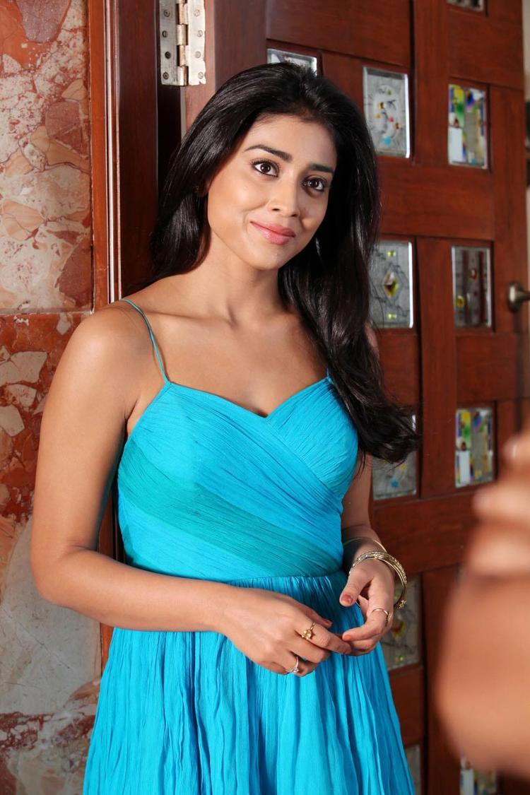 Shriya Saran Glamorous Look Photo Still In A Blue Dress From Movie Pavitra