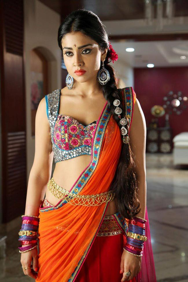 Shriya Saran Looked Hot In A Orange Color Saree In Movie Pavitra