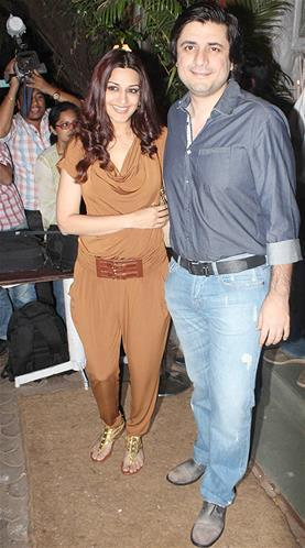 Sonali With Hubby Goldie Smiling Pose At Sanjay Leela Bhansali Birthday Bash
