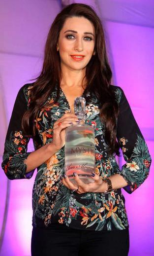 Karisma Kapoor Posed With Almond Oil At Mystic Almond Massage Oil Launch