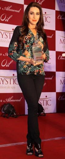 Karisma Kapoor Posed In Red Carpet At Mystic Almond Massage Oil Launch