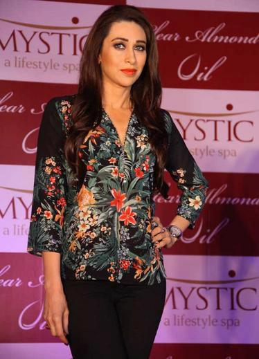 Karisma Kapoor Strikes A Pose At Mystic Almond Massage Oil Launch Event