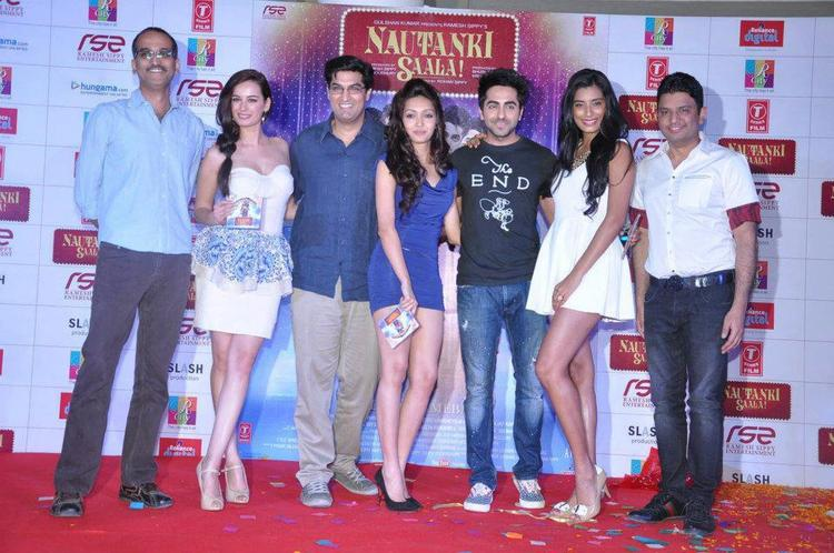 Rohan,Evelyn,Kunal,Pooja,Ayushmann,Gaelyn And Bhusan Posed For Camera At Nautanki Saala Audio Launch