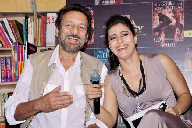 Kajol And Shekhar Smiling Pose For Shutterbugs At The Launch Of The Oath Of The Vayuputras Book