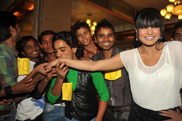 A Fan Kisses Veena Malik's Hand At Kiss Event