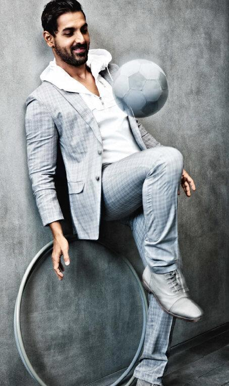 John Abraham Cool Pose With Football Photo Shoot For GQ India Magazine March 2013