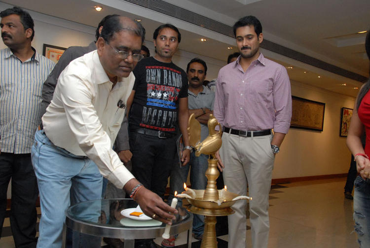 A Guest Lights The Candle And Uday Kiran Present At Tribal Beauty Art Exhibition Launch Event