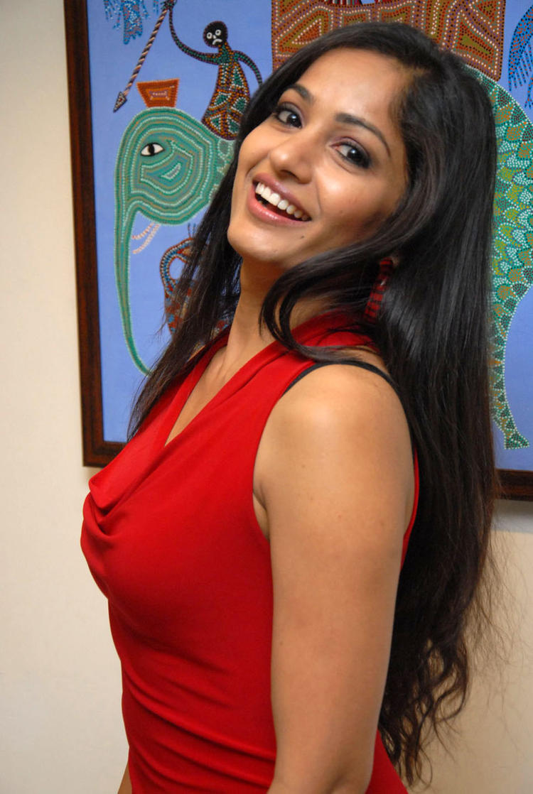 Madhavi Awesome Smile Photo Still At Tribal Beauty Art Exhibition