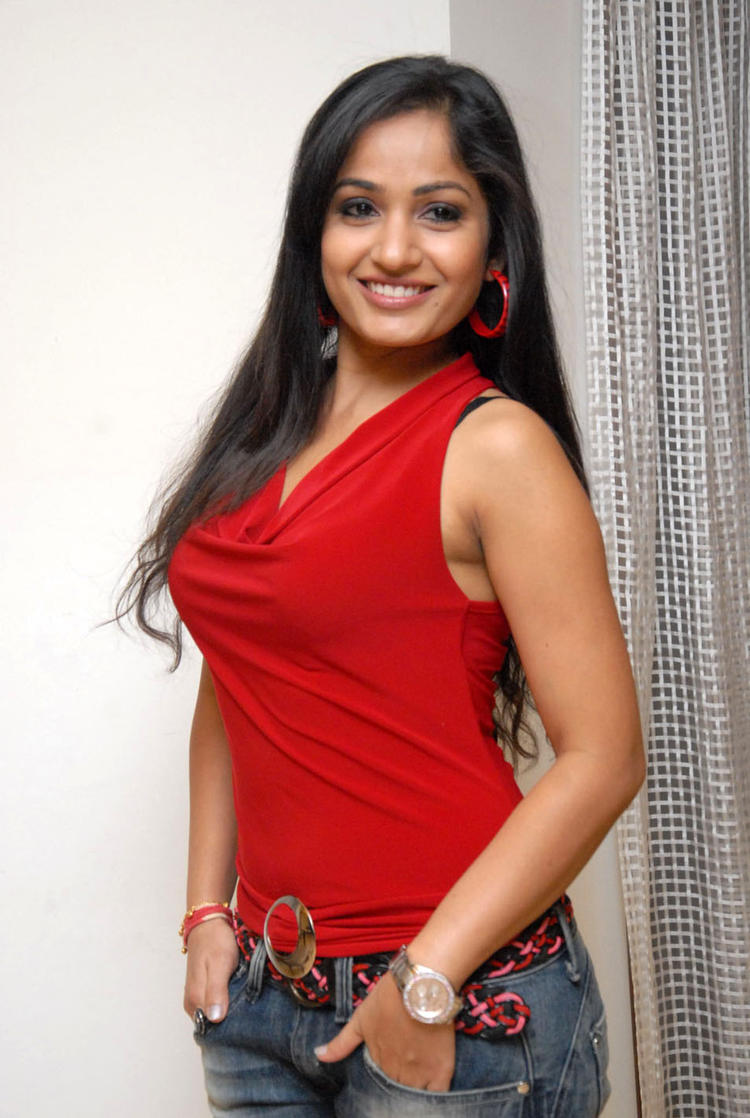 Madhavi Looked Ravishing In A Red Top And Jeans At Tribal Beauty Art Exhibition