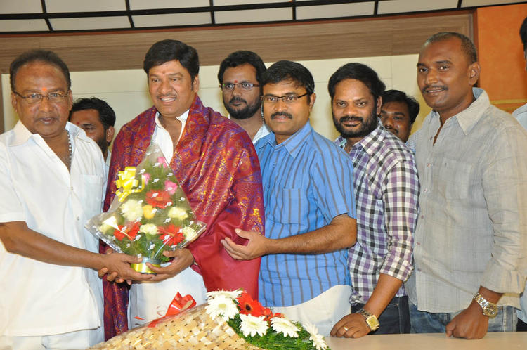 Rajendra Holding A Bouque Posed For Photo At Dream Telugu Movie Press Meet
