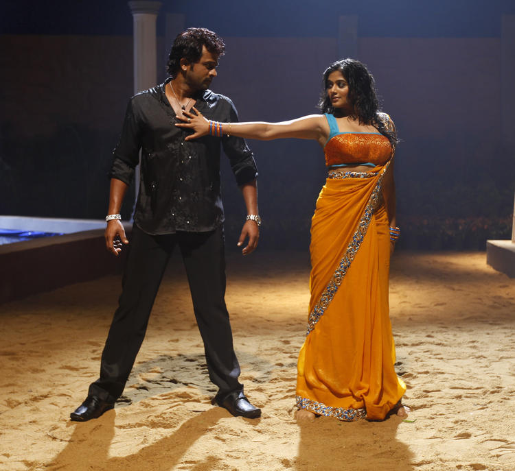 Priyamani And Krishna Sizzling Song Still From Tikka Movie