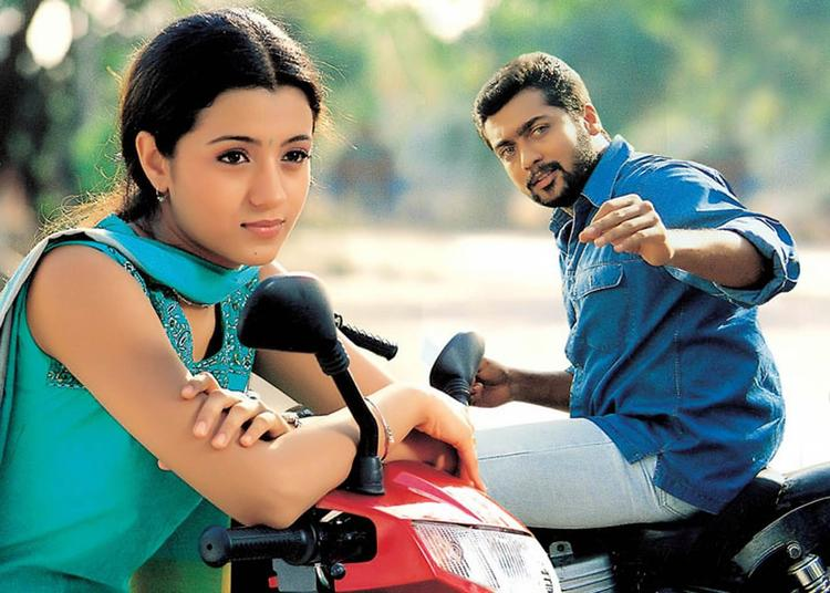 Suriya And Trisha On Bike Photo Still From Movie Kanchu