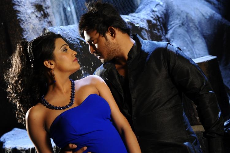 Tanish And Ramya Spicy Pose Photo Still From Movie Telugu Abbai