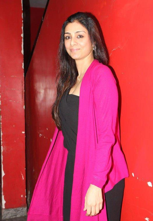 Tabu Smiling Pose For Camera At Special Screening Of Race 2