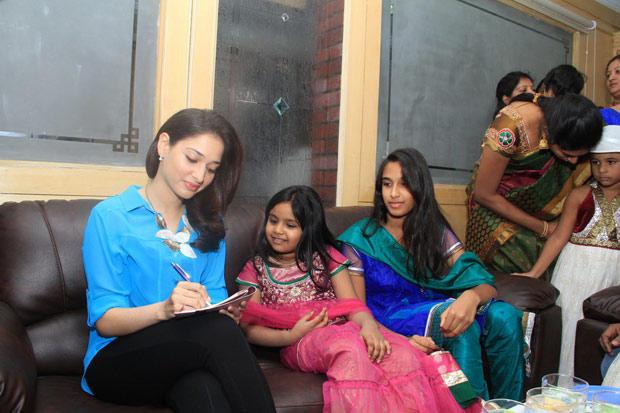Tamannaah Bhatia Signing Autographs At Sri Venkateswara College Festival