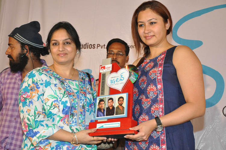 Jwala And A Guest Photo Clicked At 3G Love Movie Platinum Disc Function