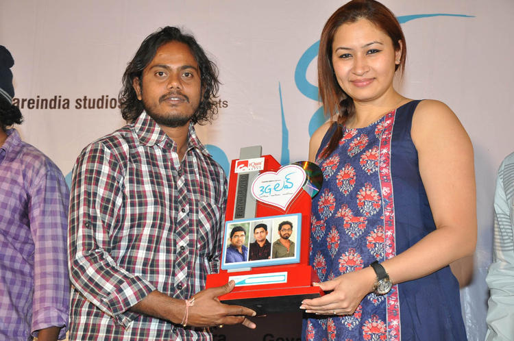 Jwala Pose For Camera At 3G Love Movie Platinum Disc Function