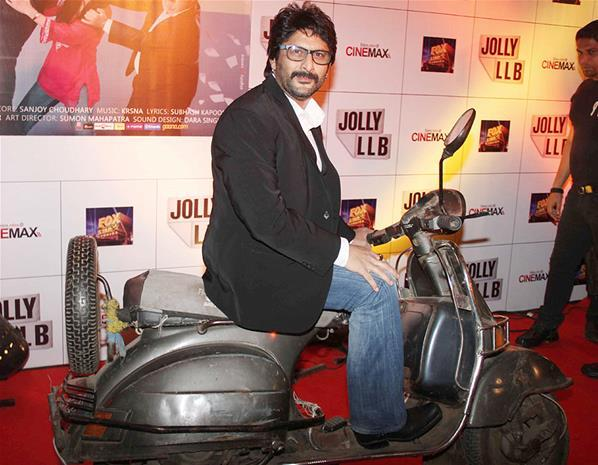 Arshad Warsi Posed With A Scooter At The Premiere Of The Film Jolly LLB