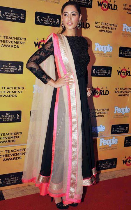 Nargis Fakhri Stylish Look In Red Carpet At Teachers Achievement Awards 2013