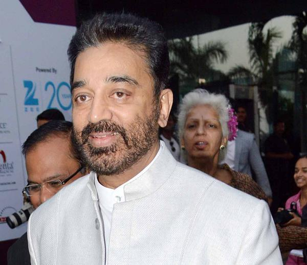 Kamal Haasan Flashes A Smile At The FICCI Frames 2013 Event
