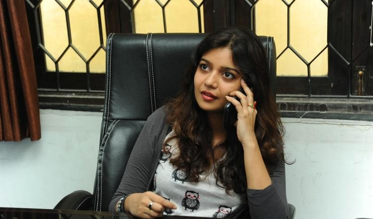 Swati Speaking In Mobile Photo Still At Swamy Ra Ra Movie Interview