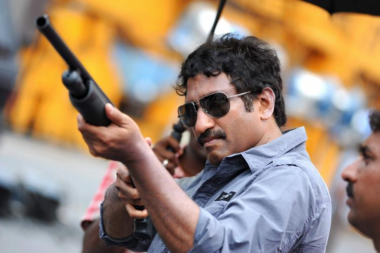 Srinu Vaitla Aiming With Gun Photo Clicked On Baadshah Movie Location