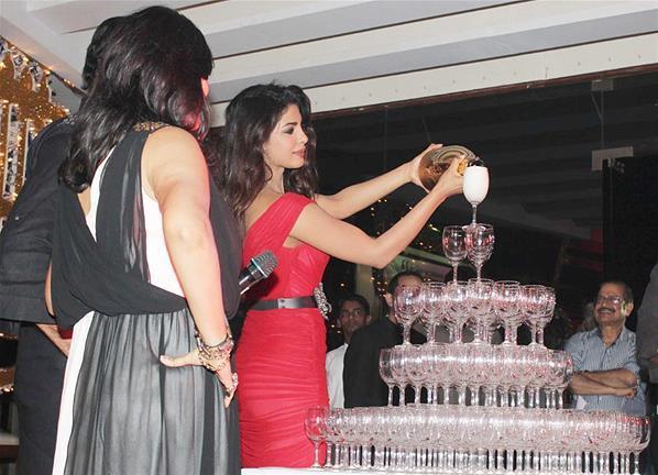 Priyanka Pour Champagne Photo Clicked At Launch Of Babli Badmaash Song