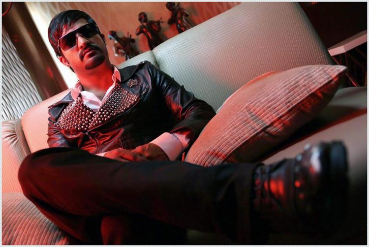 Jr. NTR Stylish Sitting Pose Photo Still From Movie Baadshah