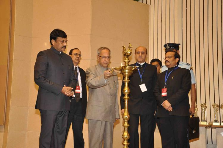 President Pranab Mukherjee Lighting The Candle, Chiranjeevi And Others Look On At National Tourism Awards 2011-2012 Presentation Ceremony
