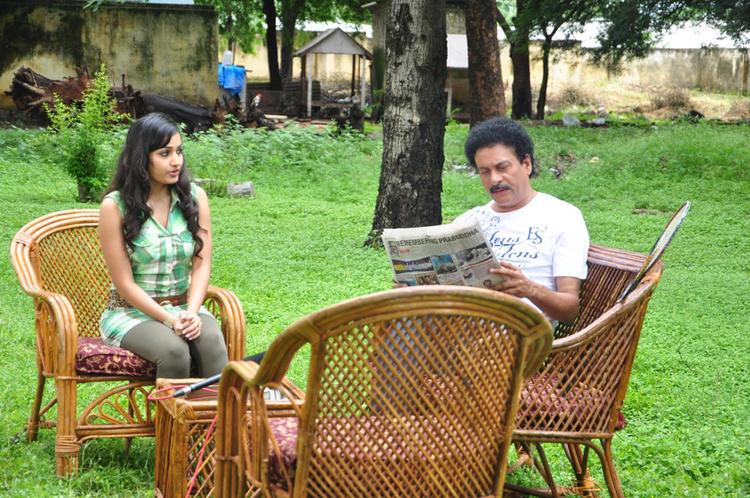 Madhavi And Srinivas Conversation Photo Still From Movie Aravind 2