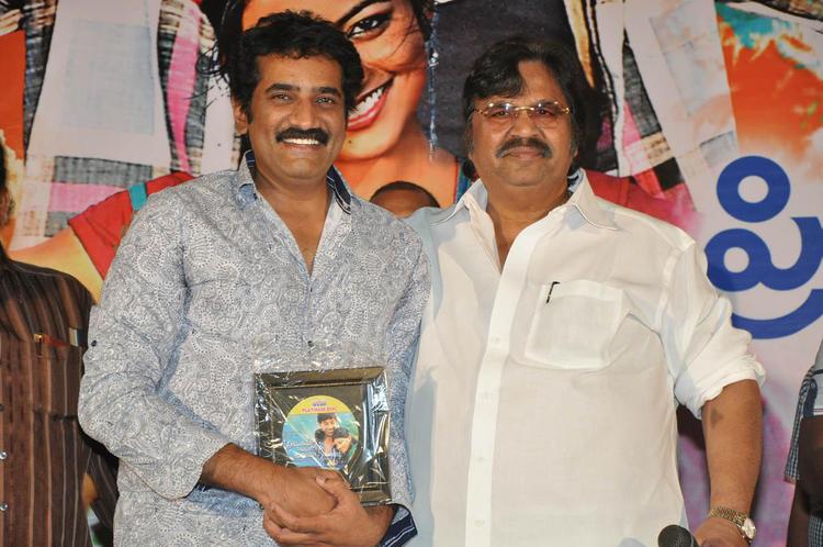 Dasari And Ramesh Smiling Pose At PNK Movie Platinum Disc Function