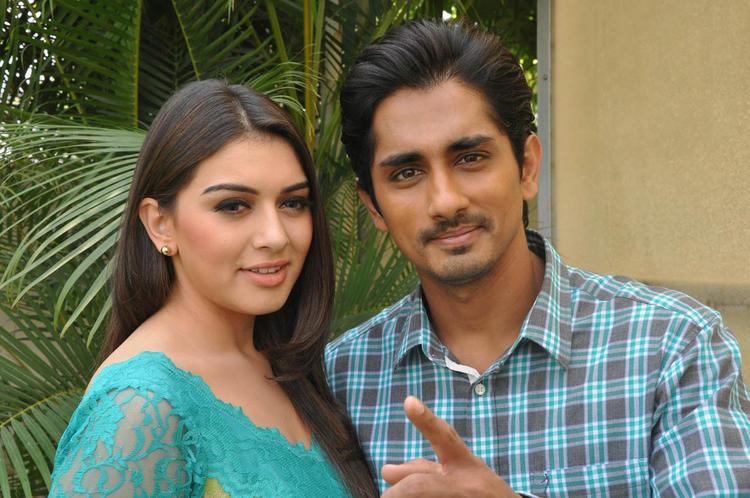 Hansika And Siddharth Cute Look Pose For Camera At Something Something Movie Press Meet