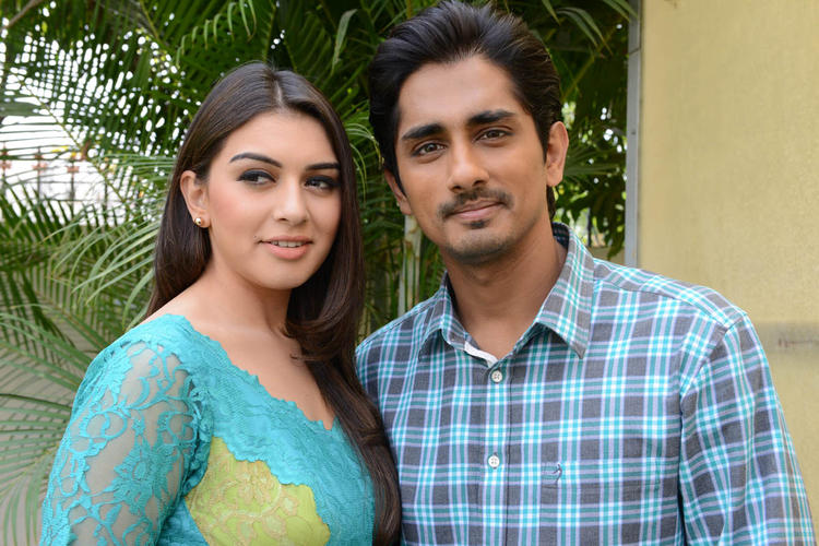 Hansika And Siddharth Smiling Pose For Camera At Something Something Movie Press Meet