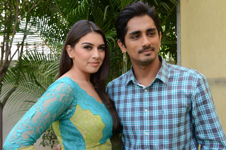 Hansika And Siddharth Strikes A Pose At Something Something Movie Press Meet