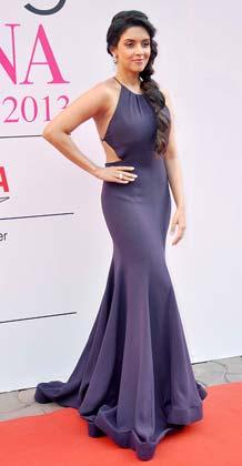 Asin Thottumkal Strikes A Glamour Look Pose At Femina Miss India Grand Finale 2013