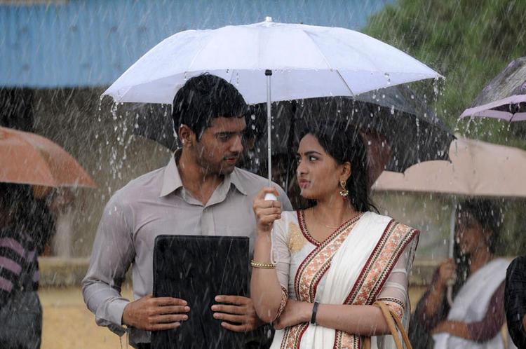 Ashwin And Srushti In Rain Photo Still From Tamil Movie Megha