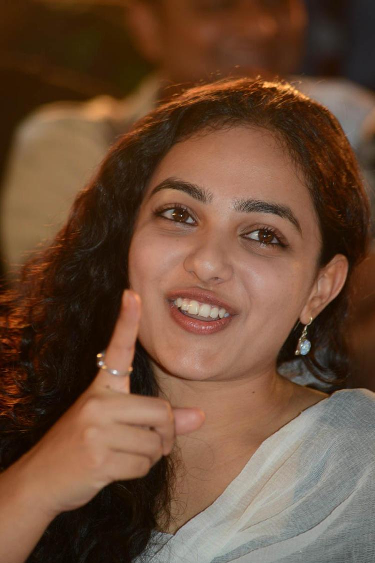 Nithya Menen Cute Look Still At Gunde Jaari Gallanthayyinde Movie Audio Release Function