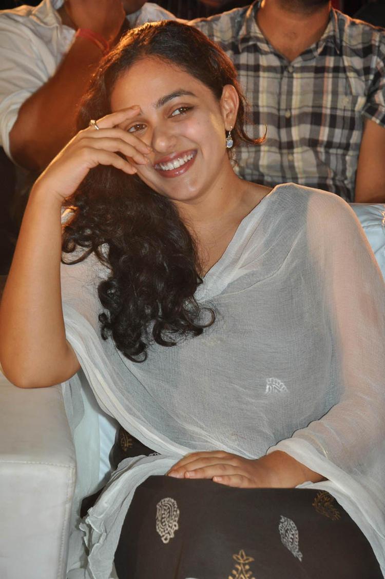 Nithya Menen Smiling Pose Still At Gunde Jaari Gallanthayyinde Movie Audio Release Function