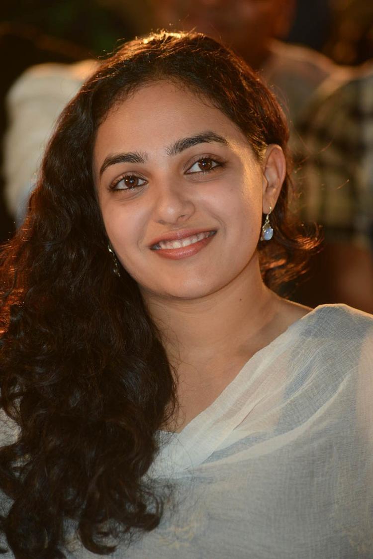 Nithya Menen Smiling Still At Gunde Jaari Gallanthayyinde Movie Audio Release Function