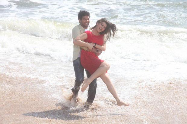 Arya And Hansika Smiling Photo Still On Beach From Movie Naughty Boys