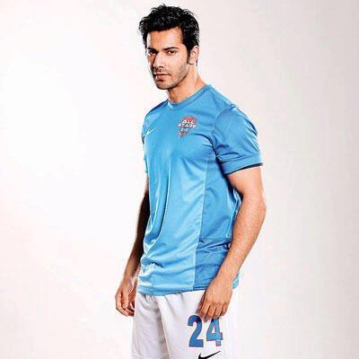 Varun Dhawan Smart Dapper Look Pose For ASFC Charity Match Ad