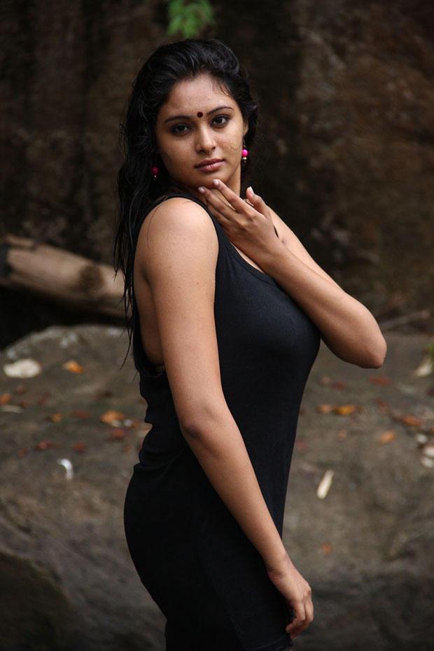 Arundhati Bold Look In Black Ensembles Still From Netru Indru Movie