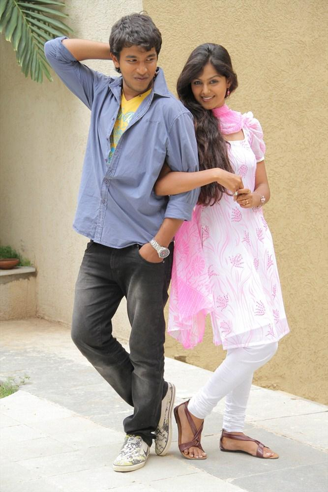 Sravan And Monal Stylish Pose Photo Still From Oka Collage Story Movie