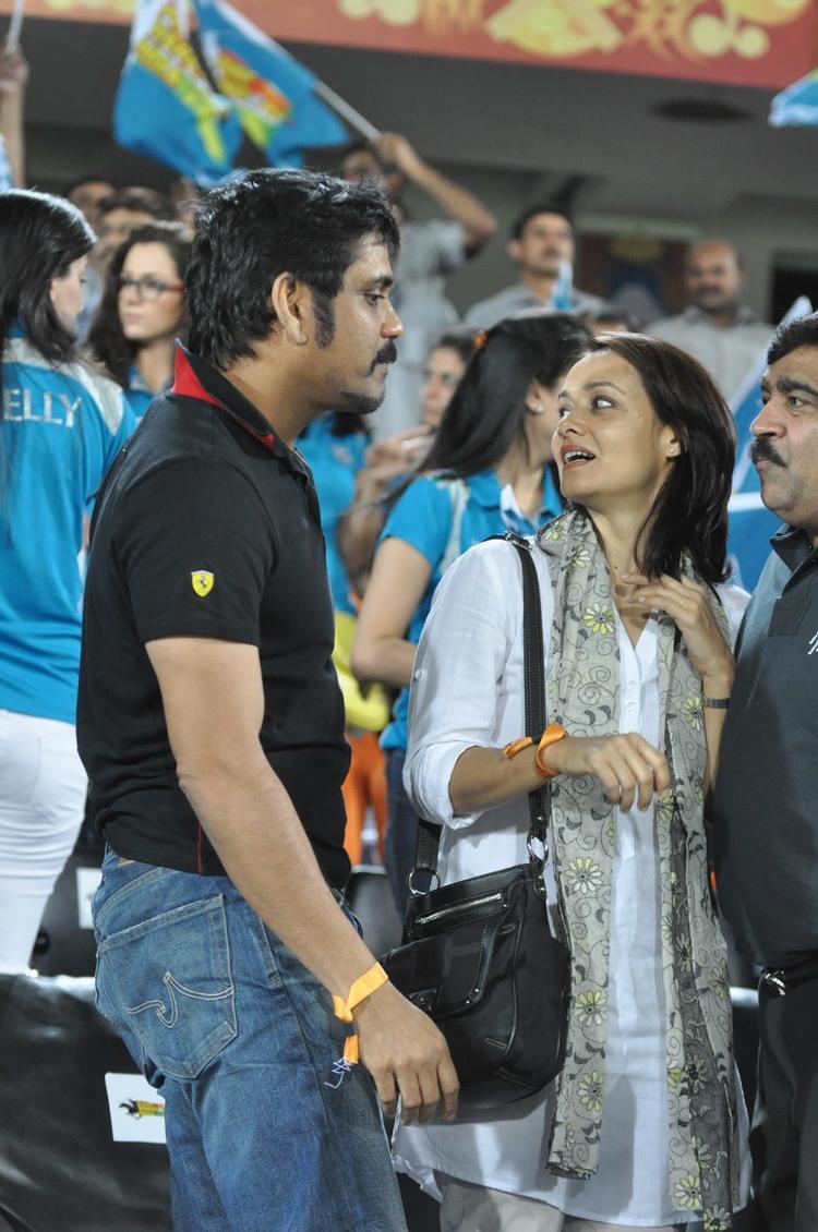 Nagarjuna With Wife Amala Spotted At Hyderabad Vs Pune IPL Cricket Match