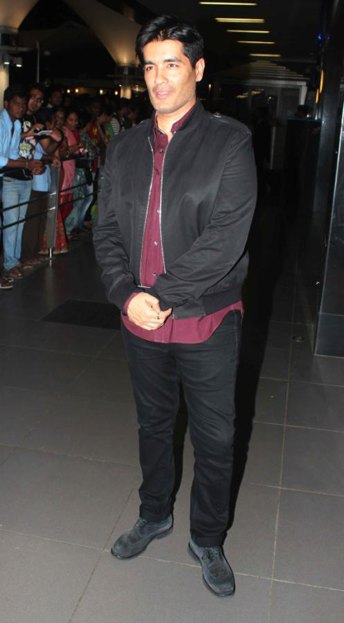 Fashion Designer Manish Poses For The Lens At Mumbai Airport On His Arrival From TOIFA 2013