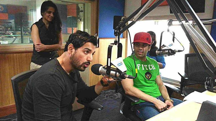 John Speaking And Tusshar Looks On During The Promotion Of Shootout At Wadala Movie  At Radio City 91.1 FM