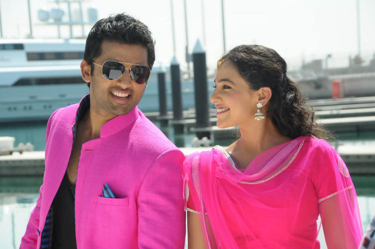 Nitin And Nithya Gorgeous Look In Pink Dress Photo Still From Movie Gunde Jaari Gallanthayindhe