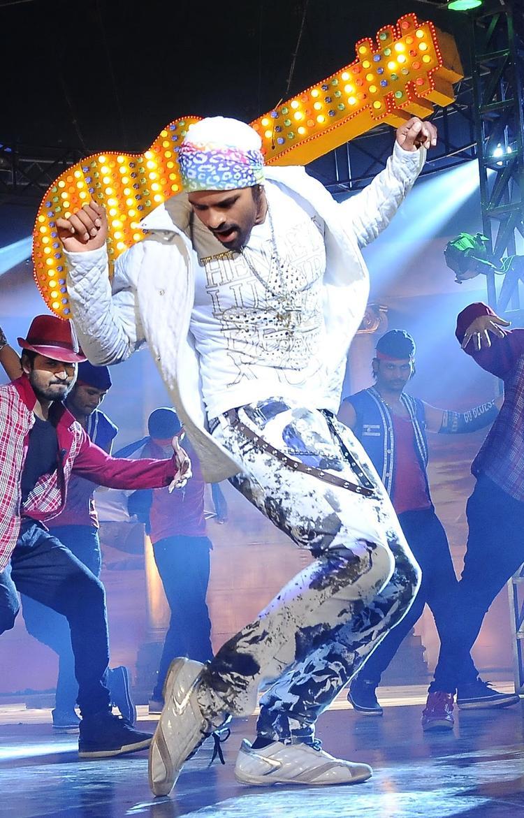 Sai Dharam Tej Hot Performing Still From Rey Movie